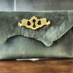 Suffolk Asymmetrical Flap Raw Cut Clutch with Vintage Escutcheon Keyplate Hardware