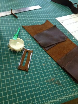 These parts are then lightly glued into place before being sewn to ensure they stay put, and then the whole case is sewn.